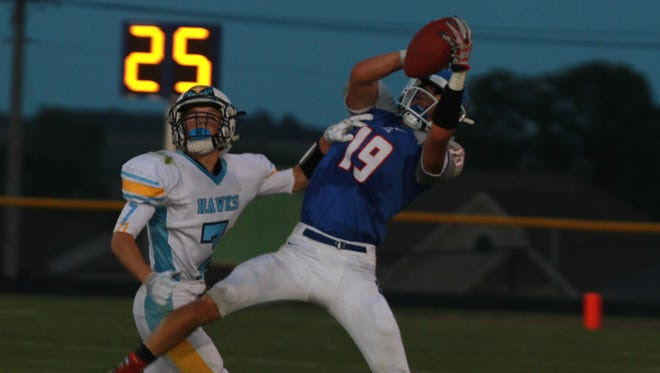 Dylan Schafbuch, 19, hauls in a pass from BGM's Jayce Knight as Lynnville-Sully's Tyson Vander Linden defends during the Bears' loss to Lynnville-Sully on Friday, Sept. 2.