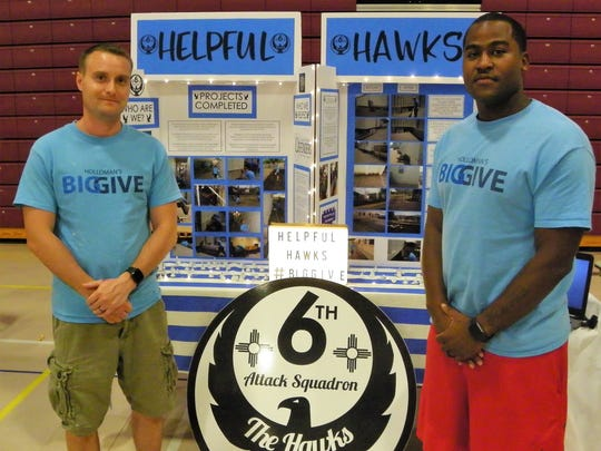 The Helpful Hawks Eric Wissler, left, and Nick Wedlow, right, won the First Place Large Group Prize at the Big Give After Party Thursday.