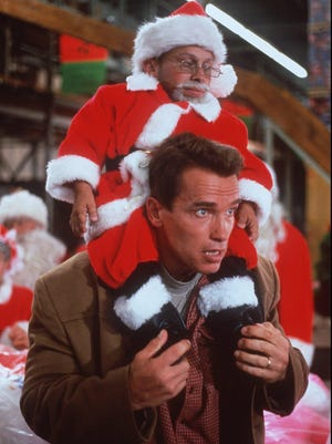 "Arnold Schwarzenegger battles a ""pint-sized"" Santa Claus, played by Vern Troyer, in ""Jingle All The Way,"" a 1996 film about a father who will do anything to get his son the action figure he wants for Christmas."