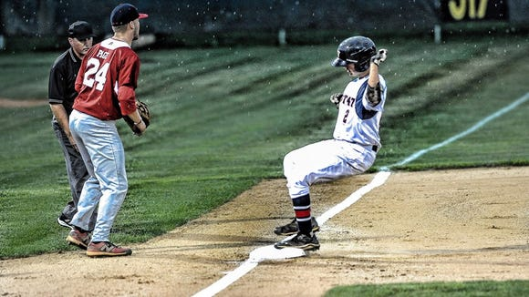 Gray McCurry was safe at third base when the rain started to pour Monday night at Lake Junaluska Elementary School.