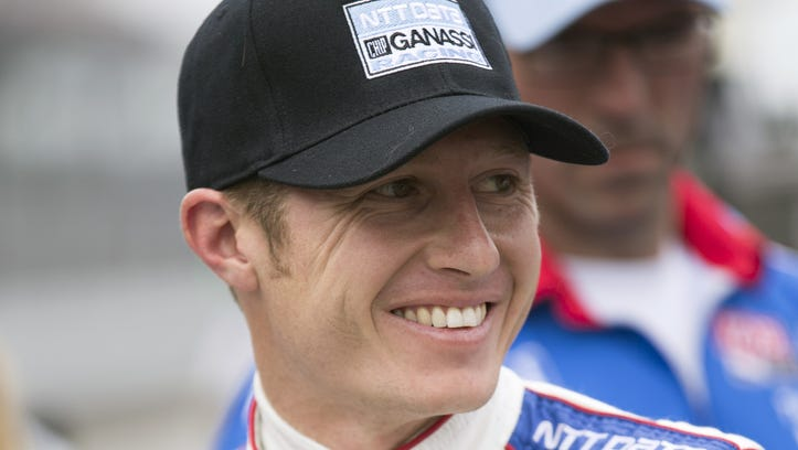 """IndyCar driver Ryan Briscoe is interviewed after a practice session on Belle Isle in Detroit, Friday, May 31, 2013. Briscoe says he was surprised to get a shot to race in the Detroit Grand Prix scheduled for Saturday and Sunday. JR Hildebrand's loss ended up being Briscoe's gain. Panther Racing terminated Hildebrand's contract Thursday after his third major mistake since joining the team in 2011. The team called it """"mutual agreement? with the 2009 Indy Lights champion, who made 37 starts in the No. 4 National Guard/Panther Racing Chevrolet. (AP Photo/Carlos Osorio)"""