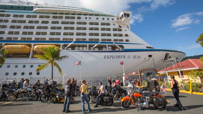 Passengers from a motorcycle cruises' tour group prepare to board the Royal Caribbean International's Explorer of the Seas, docked at Charlotte Amalie Harbor in St. Thomas, U.S. Virgin Islands, on Jan. 26.