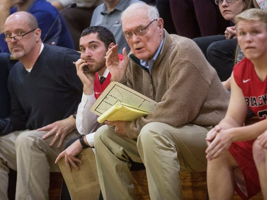 83-year old Jerry Hoover watches from the bench on