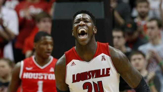 U of L's Montrezl Harrell, #24, celebrates after scoring against Houston during the first half of their game at the KFC Yum! Center. Jan. 16, 2014