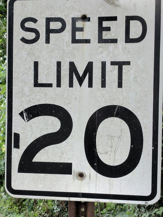 636459360616961458-tape-on-speed-sign.jpg