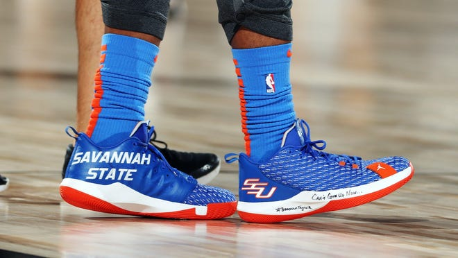 Chris Paul (3) of the Oklahoma City Thunder, wears Savannah State University-themed sneakers during a NBA game on Aug. 10, 2020 at The Field House in Lake Buena Vista, Florida.