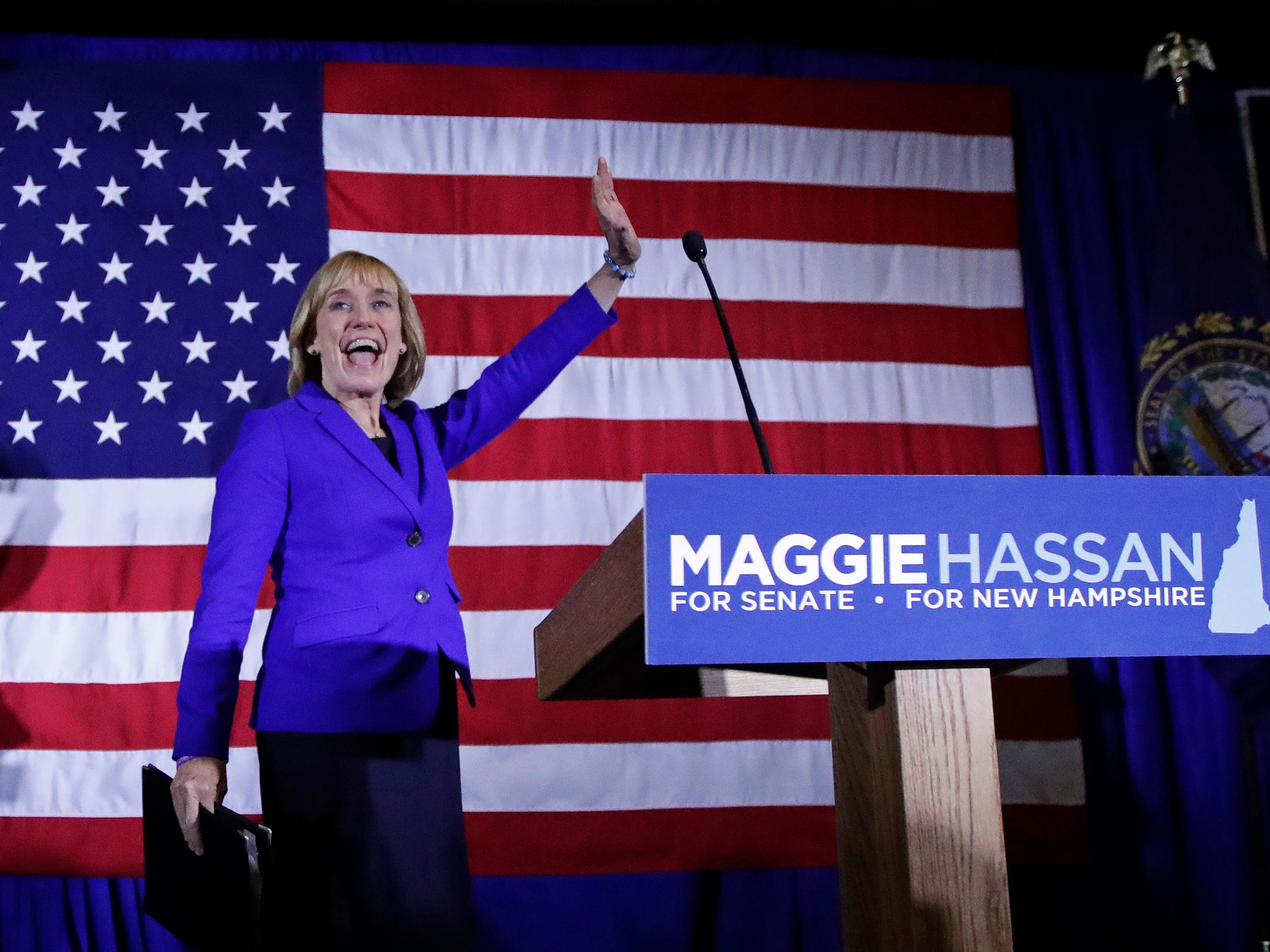 Maggie Hassan waves to supporters during an election night rally in Manchester, N.H., on Nov. 9, 2016.
