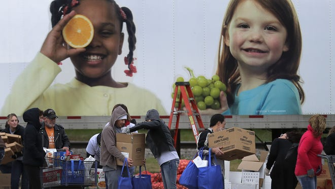 The annual Stock the Shelves campaign kicked off Friday with a mobile food pantry event at The Post-Crescent in Appleton. Wm. Glasheen/USA TODAY NETWORK-Wisconsin