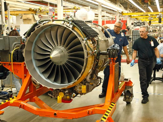 A turbine engine for an aircraft is assembled at the