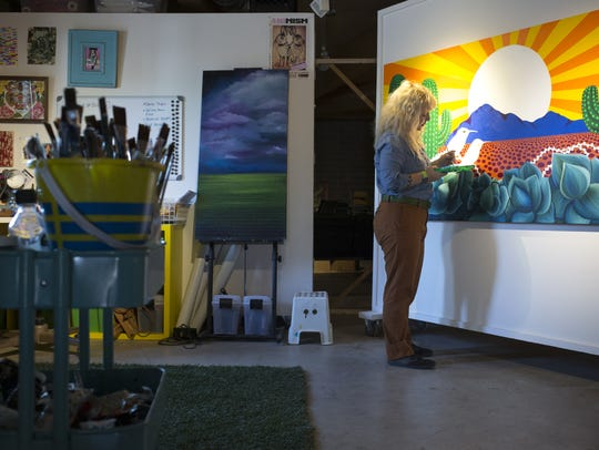 Lauren Lee paints in her studio on August 24, 2016,