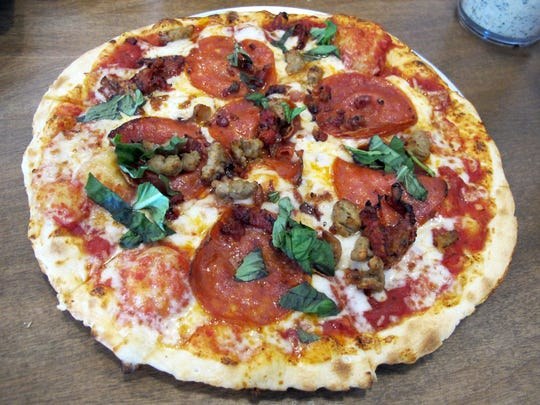 A thin crust pizza at Pie Five Pizza Co., which launched its first area location in June across U.S. 41 from Coconut Point in Estero. Personal pizzas are customized from a lineup of 40 fresh toppings, seven sauces and four crusts, then baked in only 5 minutes.