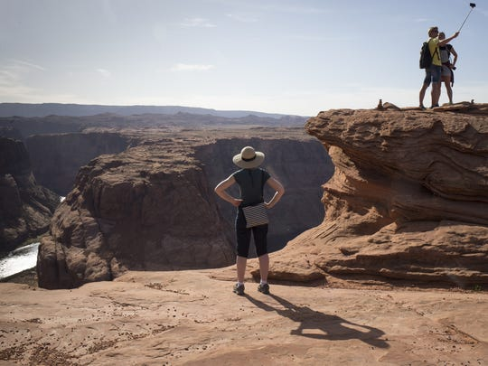 Visitors view Horseshoe Bend, April 11, 2018, Glen Canyon National Recreation Area, Page, Arizona.