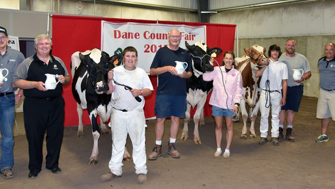AgSource Miss Q Contest award winners and successful buyers at the 2017 Dane County Fair included (from left) John Chadwick, Landmark Cooperative Services Cooperative, Doug Lambert, Farmer's and Merchants Union Bank, Nicholas Schleicher, Dr. Robert Rowe, KCF Syndicate, Kimberly Keller, Dylan Herbrand, Tony Schlimgen and Rodney Davis, AgSource Region Manager.