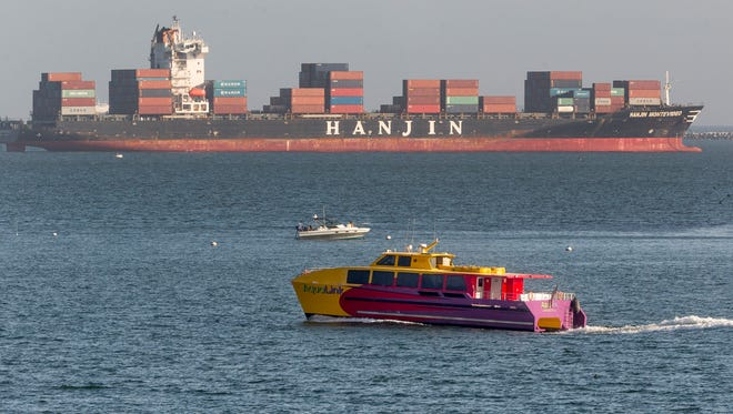 South Korea's Hanjin Shipping Co. container ship Hanjin Montevideo, top, is anchored outside the Port of Long Beach in Long Beach, Calif., on Thursday, Sept. 1, 2016.