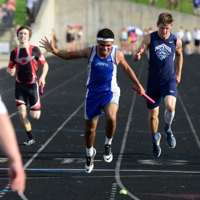 Wynford's Alizhah Watson crosses the finish line to