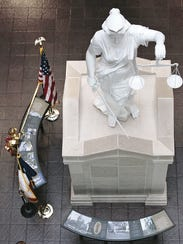 A statue of Lady Justice sits in the lobby of the El