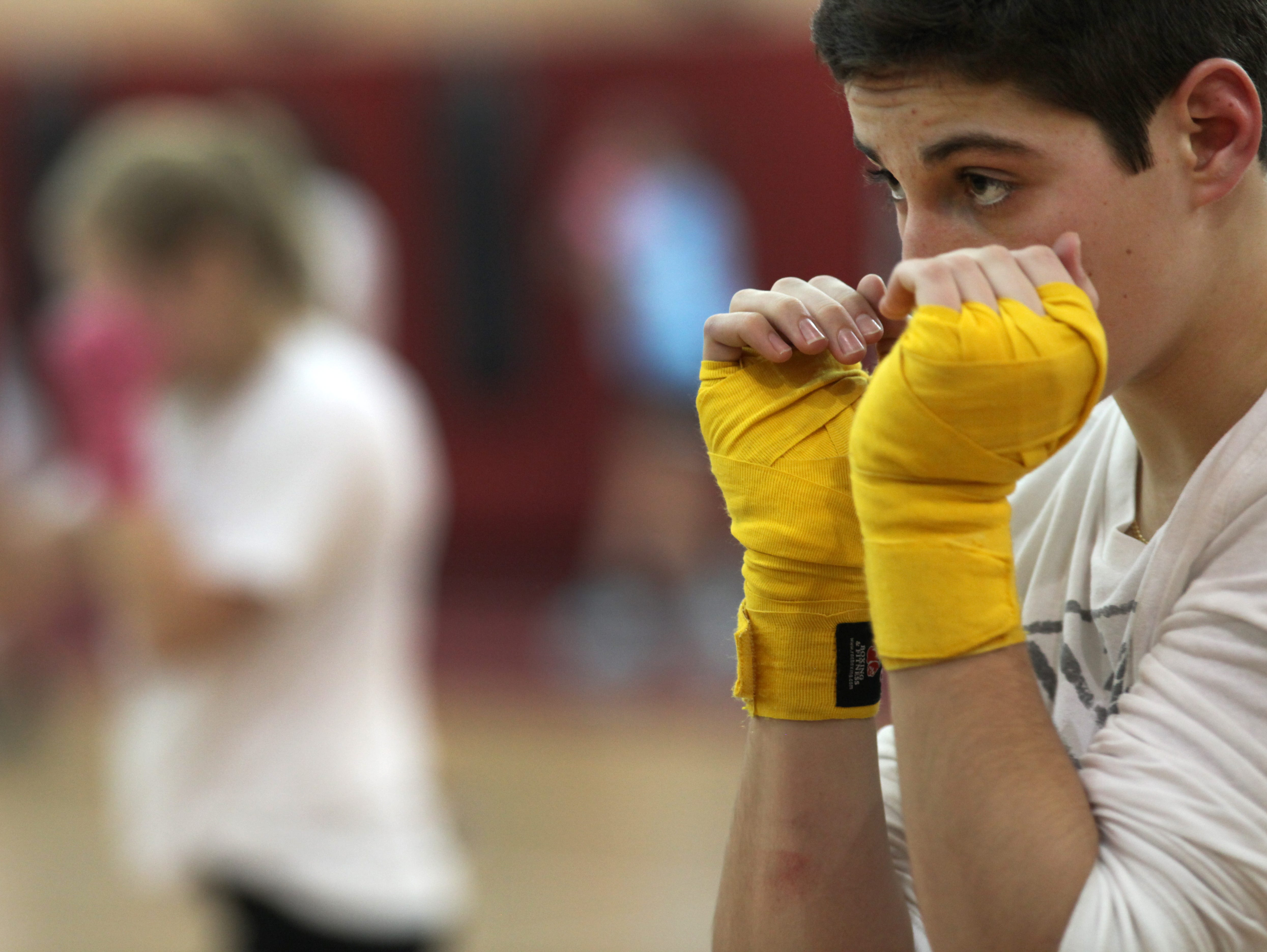 Mike Robertson works out during boxing practice at Aquinas.