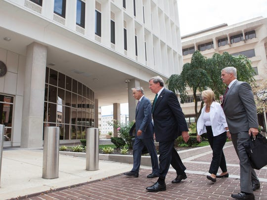 Former Wilmington Trust President Robert Harra Jr. (second from left) arrives at the federal courthouse in Wilmington on Aug. 16 for his arraignment on charges he hid past-due loans from regulators. He is accompanied by his wife, Linda (second from right), and  lawyers Michael Kelly (far right) and Andrew Lawler (far left).