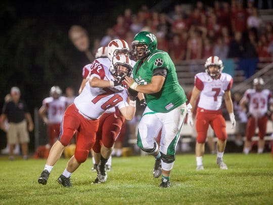 Yorktown's Anthony Todd works off a block against New