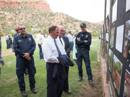 Utah Gov. Gary Herbert, white shirt, reads a memorial