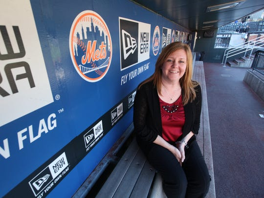 In this 2012 photo, Shannon Dalton Forde of Little Ferry sits in the dugout at Citi Field.
