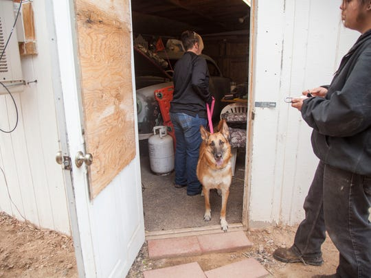 Employees of the Federal Fugitive Recovery Agency, a civilian company based in Las Vegas, and Littlefield-area residents search the shed on the property of Jerry and Susan McFalls, who have been missing for more than two months.