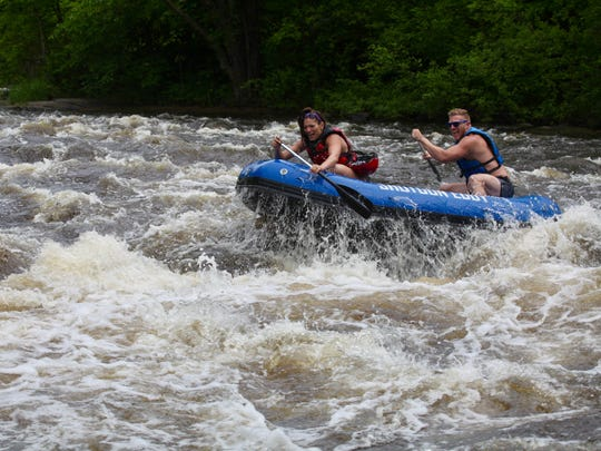 Rafters paddle through Ducknest Falls, a series of Class III rapids on the Wolf River in Menominee County.