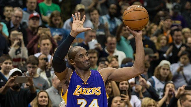 Lakers guard Kobe Bryant (24) celebrates after passing Michael Jordan.