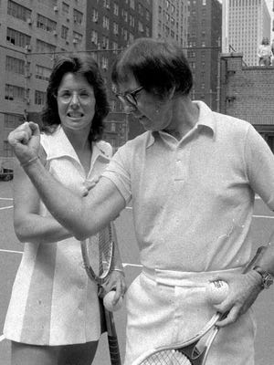 "Bobby Riggs flexes for Billie Jean King prior to their famour 1973 ""Battle of the Sexes."" King soundly defeated Riggs, scoring a big victory for female athletes."