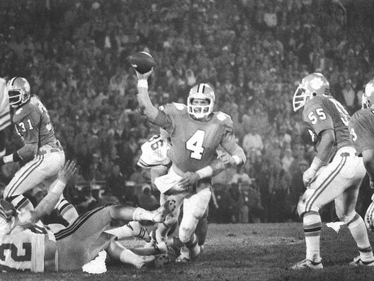 Steve Fuller (4) attempts to throw a pass against Ohio