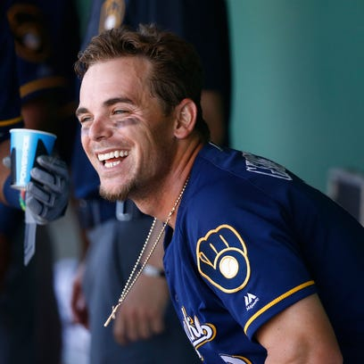 Scooter Gennett waived by Brewers, claimed by Reds