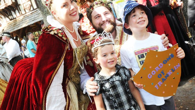 Queen Anne (portrayed by Elizabeth Clouse) and King Richard (Justin Grankewicz) pose with Myles Gordon, 5, and sister Maddie, 3, of Franklin, during the King Richard's Faire in Carver, Monday, Sept. 3, 2018. The New England Renaissance Festival, which features entertainment, rides and games through the 80-acre wooded site, runs weekends through Oct. 21 and two Monday holidays -- Labor Day and Columbus Day.