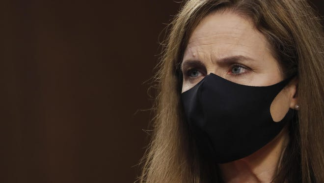 Supreme Court Justice nominee Judge Amy Coney Barrett listens during the Senate Judiciary Committee confirmation hearing for Supreme Court Justice in the Hart Senate Office Building on October 12, 2020 in Washington, DC.