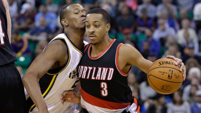 Portland Trail Blazers guard C.J. McCollum (3) drives around Utah Jazz guard Rodney Hood (5) in the first quarter during an NBA basketball game Wednesday, Nov. 4, 2015, in Salt Lake City.