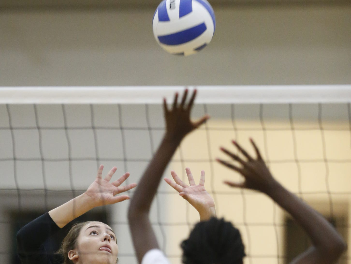 Padua's Jessica Molen reaches for the ball at the net in the second game of Padua's 3-0 win at Wilmington Friends on Thursday.