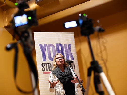 "Mindy Christian of York talks about her experience as a new mom breastfeeding during the first York Story Slam at Holy Hound Taproom in York Tuesday, January 19, 2016. Participants signed up to tell a story in five minutes or less on the night's topic, ""new beginnings""."