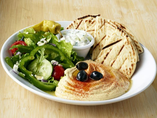 Zöes Kitchen offers a hummus platter with salad and