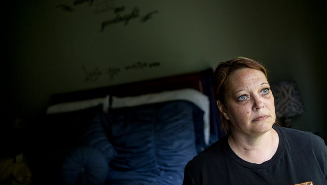 "Aimee Dort poses in the bedroom of her Kimball Township home. Dort, 40, was diagnosed with complex regional pain syndrome in 2014, which causes bouts of swelling and debilitating pain across her entire body. Dort recently began to use medical marijuana to ease her pain and to aid in her ability to sleep through the night. Dort said access to medical marijuana has been difficult, with the nearest dispensary requiring more than an hour drive round-trip. ""I'm able to do stuff that I haven't been able to do since I was diagnosed in October of 2014,"" Dort said of the effects of medical marijuana."