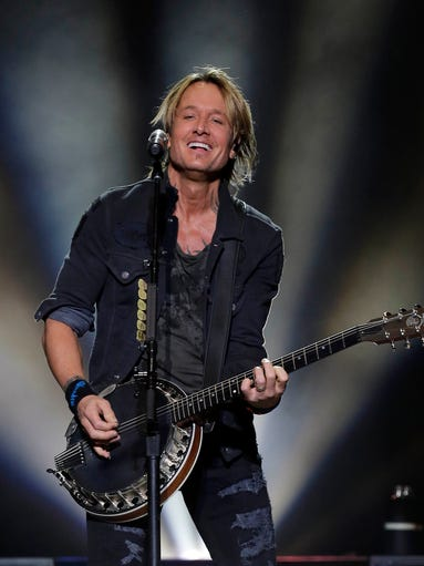 Keith Urban plays a banjo opening with Gone Tomorrow.