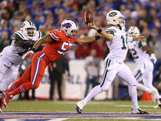 Bills linebacker Lorenzo Alexander strips the ball from Jets quarterback Ryan Fitzpatrick in the first quarter of the teams' September game.  The Jets retained possession on the play.