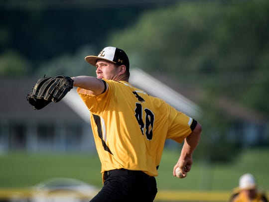 Red Lion's Tyler Burchett gets set to deliver a pitch
