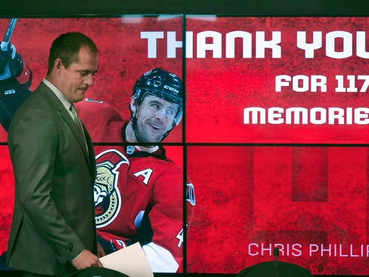 Ottawa Senators' Chris Phillips arrives for a news conference, Thursday May 26, 2016 in Ottawa, where he announced he was retiring from professional hockey. (Adrian Wyld/The Canadian Press via AP) MANDATORY CREDIT