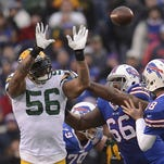 Green Bay Packers tackle David Bakhtiari (69) glares at linebacker Keith Rivers (56) during a scuffle against the Buffalo Bills from Ralph Wilson Stadium in Orchard Park, N.Y., December 14, 2014.