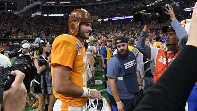 Tennessee quarterback Quinten Dormady (12) wears a leather Chick-fil-A Kickoff Game Monday, Sep. 4, 2017 after they beat Georgia Tech 42-41 in Atlanta, Ga.