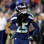 Feb 1, 2015; Glendale, AZ, USA; Seattle Seahawks cornerback Richard Sherman (25) reacts during the fourth quarter against the New England Patriots in Super Bowl XLIX at University of Phoenix Stadium.