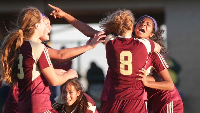Brebeuf's #18, Shaili Kumar points after hitting a goal during Girls High School Regionals, at Zionsville Youth Soccer Association, Wednesday October 14th, 2015. Brebeuf defeated Cathedral 3 to 1.