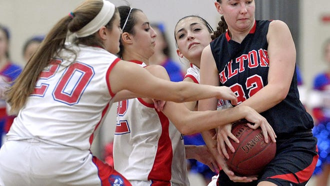 Hilton's Meaghan McGwin, right, holds the ball while pressured by Fairport's Catherine Tucci, left, Hannah Miller and Megan Yawman during a game played at Fairport High School.