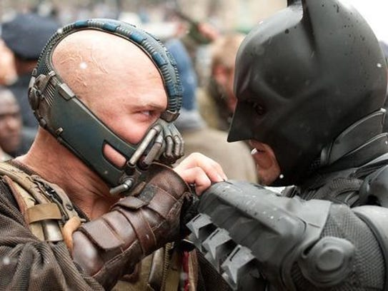 A bald Bane (left) was the nemesis of Batman. It's never explained how Bane went bald but he never seemed too happy with it.