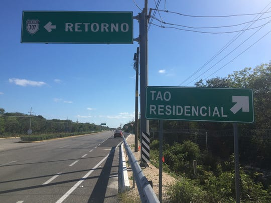 An exit sign for the Tao Mexico complex is shown here on Federal Highway 307 near Akumal, Mexico.