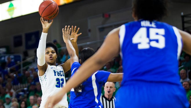 Florida Gulf Coast University forward Rosemarie Julien (32) shoots a three pointer during the game against University of Kentucky at Alico Arena in Fort Myers on Friday, Dec. 8, 2017.